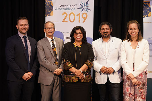 Speakers from WTA2019 together in front of banners